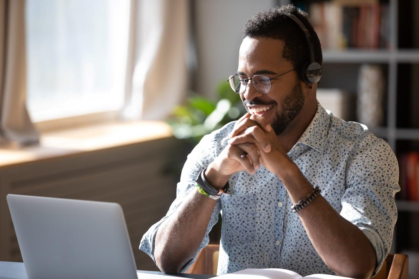 Man looking at laptop managing connectivity